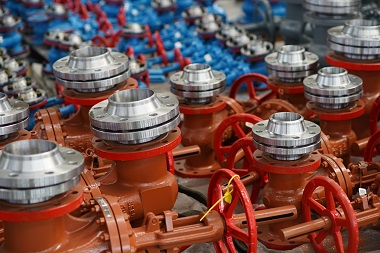 Series of neatly arranged red gate valves by the gate valve manufacturer
