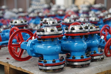 Display of many globe valves painted in red and blue